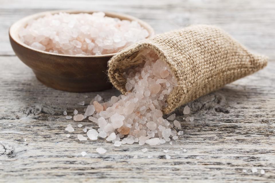 Himalayan pink salt in a burlap sack