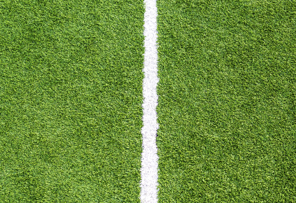White line on soccer field grass